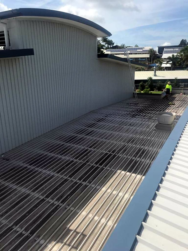 Commercial Building Roof Cleaning Before